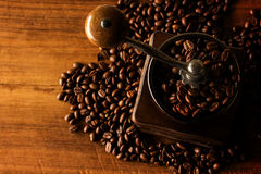 Antique coffee grinder with coffee beans. In the blurred background stock photo