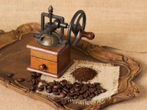 Antique coffee grinder. Ground coffee and coffee beans Stock Photo