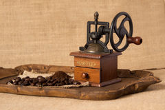 Antique coffee grinder. Ground coffee and coffee beans Royalty Free Stock Photography