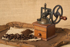 Antique coffee grinder. Ground coffee and coffee beans Royalty Free Stock Photo
