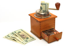 Antique coffee grinder with money Royalty Free Stock Image