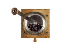 Antique coffee grinder. Photo of an antique coffee grinder isolated on a white background stock image