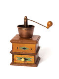 Antique coffee grinder. On white background stock images