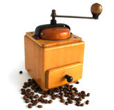 Antique coffee grinder. Antique wooden coffee grinder with coffee beans royalty free stock image