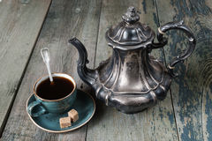 Antique coffee pot and cup of coffee Royalty Free Stock Photo