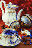 Antique coffee pot with historical christmas balls. Stock Images