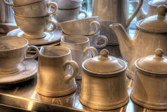 Antique coffee set. Old coffee set on a table enlightened by spotlights Royalty Free Stock Images