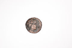 Antique coin with a portrait on a white background Royalty Free Stock Images