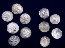 Antique coins. Antique greek silver coins on dark background Royalty Free Stock Photography