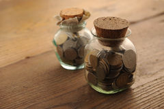 Antique coins. Old coins on the wooden table stock images