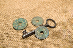 Antique  coins  and keys  on old cloth Royalty Free Stock Image