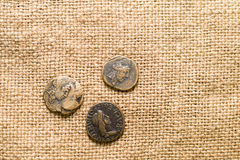 Antique  coins with portraits of emperors  on old cloth Stock Photography