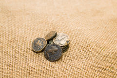 Antique  coins with portraits of emperors  on old cloth Royalty Free Stock Images
