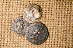 Antique coins with portraits of emperors are on sacking Royalty Free Stock Photos