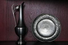 Antique Colonial Sivler Pitcher and Pewter Plate Royalty Free Stock Images