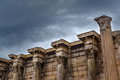 Antique columns in Athens. Antique columns, capitals, Corinthian order, the wall of Hadrian's Library Royalty Free Stock Photos