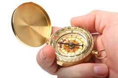 Antique compass. Antique brass compass isolated on white background stock photo