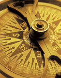 Antique Compass. Antique maritime compass in golden light Royalty Free Stock Image