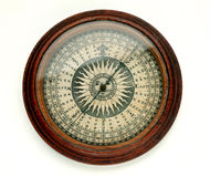 Antique compass. Antique round wooden compass on white background stock photography