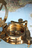 Antique compass. Antique, bronze compass on the map stock images