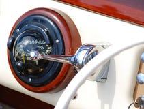 Antique compass in a boat. Antique compass in a vintage boat royalty free stock image