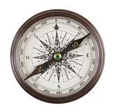 Antique compass in a brass case. On white background royalty free stock photos
