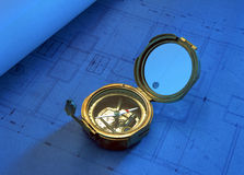 Antique compass on drawing plan royalty free stock photo