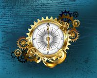 Antique compass with gears Steampunk. Antique compass with gold and brass gears on turquoise wooden background royalty free illustration