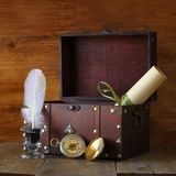 Antique compass, inkwell and old wooden chest on wooden table Stock Photo