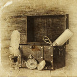 Antique compass, inkwell and old wooden chest on wooden table. black and white style old photo Royalty Free Stock Image