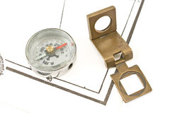 Antique compass and magnifying glass Stock Images