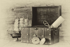 Antique compass, manuscript, old vintage chest on wooden table. black and white style old photo Royalty Free Stock Images