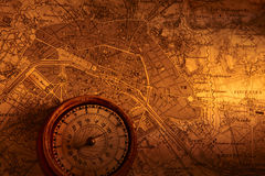 Antique compass and map. Antique compass on a map in sepia tones royalty free stock images