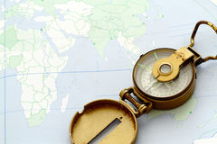 Antique Compass on a map Stock Images