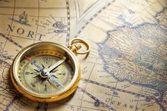 Antique compass on map. Antique compass on antique map with big word india royalty free stock photography