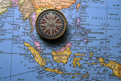 Antique compass on map (South East Asian Region) Royalty Free Stock Photography