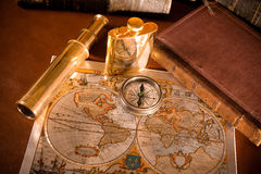 Antique compass  And old map. An antique compass and spyglass sitting on an old map Stock Photography