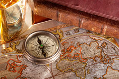 Antique compass  and old map. An antique compass  an old map concept Royalty Free Stock Photography