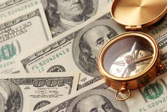 Antique compass over money Stock Photography