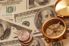 Antique compass over money. Antique compass over 100 dollar bills background stock image