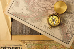 Antique compass over old map. Antique brass compass over old map royalty free stock image