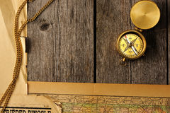Antique compass over old map Stock Images