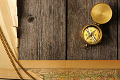 Antique compass over old map Royalty Free Stock Photos