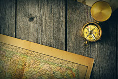 Antique compass over old map Royalty Free Stock Images