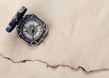 Antique compass over old paper background Royalty Free Stock Photos