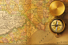 Antique compass over old XIX century map Royalty Free Stock Image
