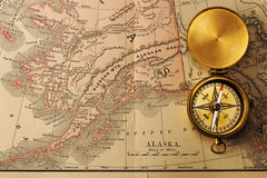 Antique compass over old XIX century map. Antique brass compass over old XIX century map royalty free stock images