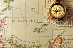 Antique compass over old XIX century map. Antique brass compass over old XIX century map stock image