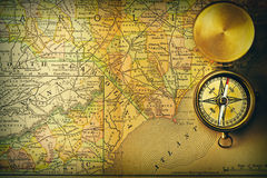 Antique compass over old XIX century map. Antique brass compass over old XIX century map Stock Photos