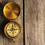Antique compass over wooden background Stock Photography